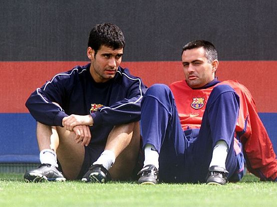 Happier Times: The pair discuss football (probably).