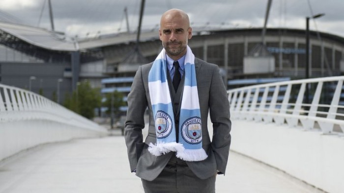 Pep bought a scarf in prep for Manchester's weather.