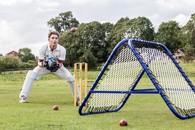 cricket wicketkeeper using spring back stumps and rebound net during net practice